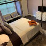 bed-HDTV-queen-room-huffman-house-bed-and-breakfast-1108 Broadway-minden-la